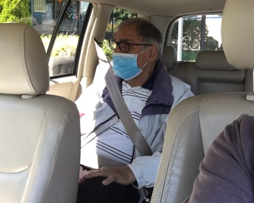 One of our clients being driven to a medical appointment by a volunteer